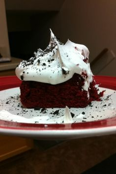 Red velvet cake with cream cheese pudding in the middle and cool whip on top with Oreo crushed on top!