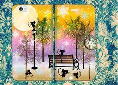 手帳型スマホケースL 黒猫たちの冬の公園