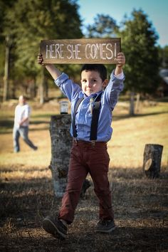 Cute ring bearer with sign for rustic wedding | Let us help plan all the details for your perfect day! www.PerfectDayWeddingPlanners.com #ChicagoWeddingPlanners