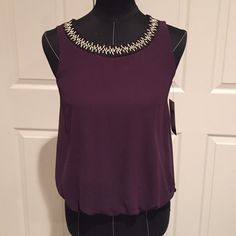 NWT.  A. Byer. Accent top Sheer burgundy top with elastic at waist. Black trim with metal accents at neck A. Byer Tops