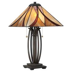Modeled after classic Tiffany designs, this valiant bronze-finished table lamp showcases a stained glass-inspired shade that gently filters light.