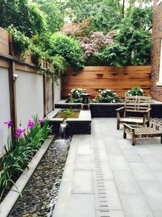 Youd be surprised how well a small patio can take on water features. This urban garden in Washington D. has a wonderfully scaled stepped-down narrow trough fountain that hugs the perimeter of the patio and helps to mitigate the city noise. Small Backyard Gardens, Backyard Garden Design, Small Backyard Landscaping, Small Garden Design, Garden Spaces, Backyard Patio, Outdoor Patios, Outdoor Fun, Landscaping Ideas