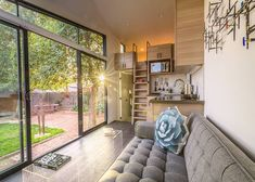 Nestled in a backyard in sunny Arizona, this contemporary tiny house on wheels offers big comforts in a tiny footprint.