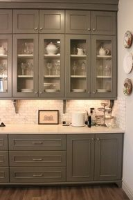 Medium Grey Kitchen with Wood Flooring- I like the colored cabinets, but I don't know if I will like them ten years from now...