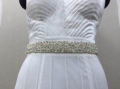 A personal favourite from my Etsy shop https://www.etsy.com/in-en/listing/400447883/rhinestone-belt-with-pearl-combination