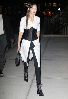 We love how Gigi incorporates forward accent pieces into her look—like this corset here. It's an easy way to make any ensemble that much more current.