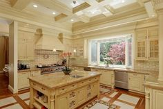 Love this kitchen in this East Coast inspired Tudor style home