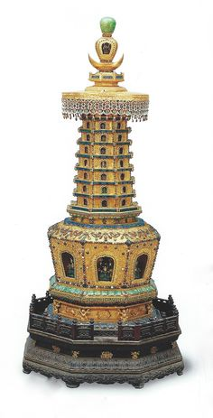 A bejeweled golden octagonal stupa pagoda masterpiece inlaid with pearls, red coral, jade and other semi- precious stones, Qing Dynasty, on display in the Forbidden City Museum Palace collection. Overall Height: 122cm; Base Length: 23cm.