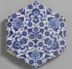 Hexagonal tile with cloud bands, arabesque medallions, & stylized lotus flowers  Architectural Element  Turkish  ,  16th century  Ottoman Empire, AH 680-1342 / AD 1281-1924  Creation Place: Iznik, Turkey  Glazed hexagonal fritware  H: 1.5 x W: 24.4 x Depth: 2.5 cm (8 7/16 x 9 5/8 x 1 in.)