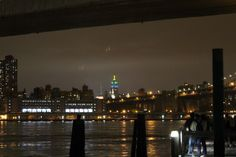 Manhattan Skyline from Brooklyn Bridge Park at Dusk with Empire State Building in the Distance