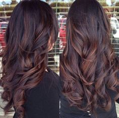 Dark brown hair with auburn lowlights                                                                                                                                                                                 More