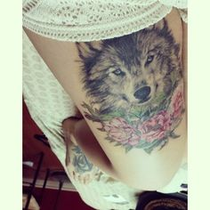 Wolf and roses tattoo on thigh