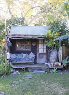 Tiny House / The Green Life corrugated roof, porch, lazy days. Cabin at the back of Bruce Goold's house - as featured in the Design* Sponge Sneak Peek - an Australian Artist's Beach Retreat Cabins And Cottages, Beach Cottages, Beach Shack, Surf Shack, Cabins In The Woods, Little Houses, My Dream Home, House Plans, House Design