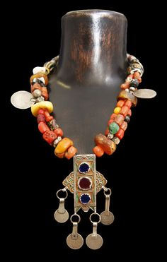 Morocco | Necklace made from coral, glass beads, amber, coins and enameled focal pendant | ca. Early 20th century | 1950$