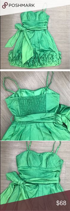 """GREEN BIG BOW RUFFLE DRESS BEAUTIFUL GREEN RUFFLE DRESS. Color: different tones of green. Brand si style for Asos. Used once for a wedding. Its a size small, stretches in the back. Bust measurements is 32"""" -36"""" but stretches in the back and can fit up to size 36"""". Ask all questions before buying.                                                                    💗Condition: EUC, No flaws, no rips, holes or stains 💗Smoke free home 💗No trades/No returns 💗No modeling 💗Shipping next day…"""