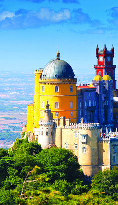 Journey to the top of the Sintra-Cascais National Park to discover the Pena National Palace. This national monument, which began construction during the Middle Ages, offers sweeping views of Lisbon, Portugal.