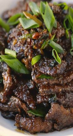 PF Chang's Mongolian Beef2 teaspoons vegetable oil 1/2 teaspoon ginger, minced 2 tablespoon garlic, chopped 1/2 cup soy sauce 1/2 cup water 1/2 cup dark brown sugar Vegetable oil, for frying 1-1/2 lb flank steak 1/4 cup cornstarch 2 cups of one-inch lengths green onions