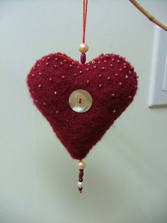 beaded heart with mother of pearl button made from wool sweater scrap