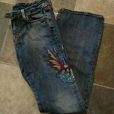 RARE, design by Melina, denim with embroidery These are from a California boutique and her designes would sell for much more than most high end denim.  These are labeled boot stretch, I feel like the bottoms of the legs are between boot cut and flare.  There left outer thigh has a beautiful fairy embroidered in it.  A boho chic score for sure!!  *ready to ship * like new * UNIQUE Vigoss Jeans