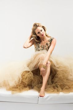 A fashion editorial featuring Estella Warren with LoveGold
