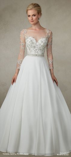 A beautiful A-line chiffon skirt with beaded waistband, exquisite sleeves and illusion back