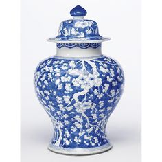A CHINESE BLUE AND WHITE BALUSTER JAR AND COVER KANGXI (1662-1722) painted with prunus branches on a 'cracked ice' ground. Rim of cover ground.