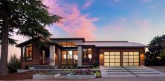 Similar to tesla solar roof house, low pitched roof, nice mix of grey, wood, and stone
