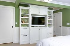 The wallpaper behind these shelves is a great idea. Click on the picture to see how this green is used throughout the other rooms in this house