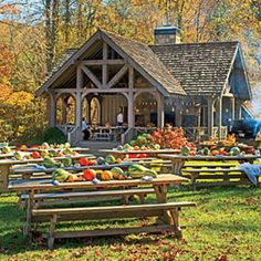 An array of colorful gourds line the center of tables -  Blackberry Farm - Erica George Dines, photographer