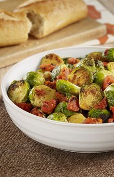 Delicious Oven Roasted Brussels Sprouts with tomatoes add a rustic touch to your Thanksgiving side dish menu.