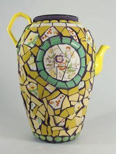 pique assiette tea pot - handle and spout   pieces on symetrical  vase