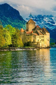 Chillon Castle on Lake Geneva, with Alps in the background. 10 Things to do in Montreux, Switzerland Chillon Castle on Lake Geneva, with Alps in the background. 10 Things to do in Montreux, Switzerland Lake Geneva Switzerland, Switzerland Cities, Visit Switzerland, Places To Travel, Places To See, Travel Destinations, Travel Europe, Travel Tips, Yvoire