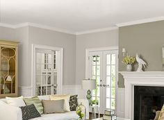Love this gray (BM Barren Plain) and off-white combo.  Crown molding and wainscoting!!!