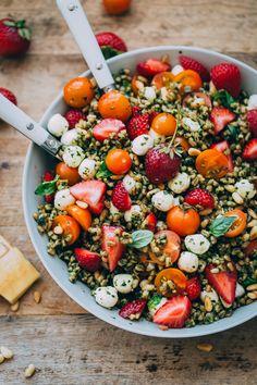 Strawberry Caprese Farro Salad - farro is tossed with homemade pesto, strawberries, tomatoes, and mozzarella to create a healthy, summer farro grain salad.