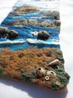 Original hand-felted, 3D wallhanging, using Shetland, Cheviot, Jacob and Black Welsh wool and incorporating tiny shells and driftwood, picked up on the shores of Scotland. See more by LittleDeb on Pinterest, Facebook and Etsy. Wet Felting, Needle Felting, Felt Wall Hanging, Lavender Bags, Felt Ball, Green Cotton, Welsh, Driftwood