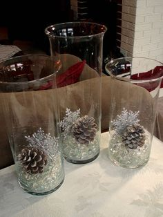 ~ love the simplicity of this winter decor. Dollar Store marbles, vases, glittered snowflakes, & pinecones. *