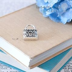 small decorative silver lock shaped charm. DIY wedding stationery supplies