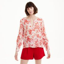 Taember Top - Featuring an updated French toile pattern in a fresh red-on-white palette, the Taember top is made from a subtly textured lightweight fabric and finished with knife-pleated ruffles at the sleeves.