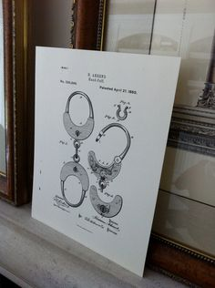 vintage print of handcuffs from 1880