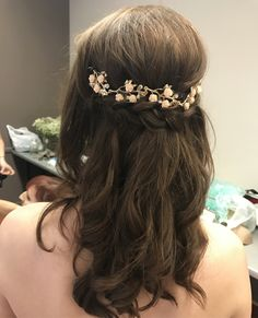 Bridal updo half up half down rose gold hair piece curled hairstyle wedding hair braided with flowers