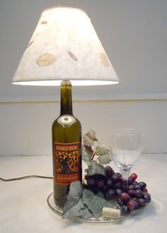 Turn your old wine bottle into a lamp. It is a great way to stay lit.  http://www.snooth.com/articles/diy-wine-cork-and-bottle-crafts/