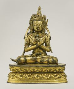A Gilt Copper Alloy Figure Depicting Vajradhara Height: 12 1/4  in. (31.1 cm) Tibet, 15th century