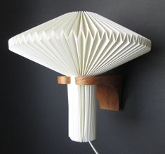 Original Danish Le Klint wall lamp (sconce) in folded and pleated paper and teak wood in 110 or 220 volt, design attr. to Vilhelm Wohlert by SCALDESIGN on Etsy