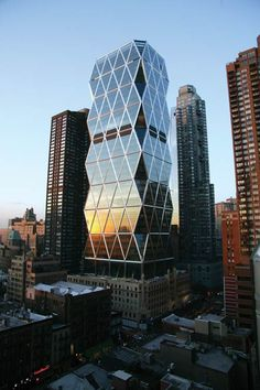 Eco-architecture - Hearst Tower in New York City.  Architect: Sir Norman Foster  | The building is Gold LEED Certified with over 90% of the structural steel used containing recycled materials.