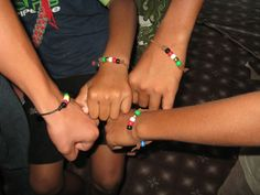 Wordless bracelets to help kids tell others the Good News  Black = Everyone Sins  Red = Jesus Shed His Blood for You  White = Accepting Him makes you clean from sin  Gold/Yellow = He has prepared a place for you in heaven  Green = Grow in Christ
