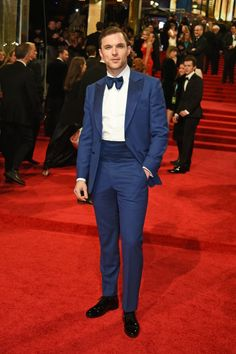 Ed Skrein in Chester Barrie suit and Jimmy Choo shoes. BAFTA 2017.