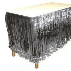 Silver Metallic Fringed Table Skirt | Windy City Novelties   $5.81 per 11 feet    30 inches long,  not as thick as picture, may have to double it up. flimsy material so be careful putting it on table.