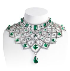 Fabergé - Romanov Necklace. A spectacular necklace, inspired by an historic design, superbly crafted and articulated in white gold to spread over the shoulder and neckline in an openwork trellis, with a soft, vintage lustre, and a dramatic array of emeralds of exceptional quality. The choker detaches from the collar, allowing the two necklaces to be worn separately.