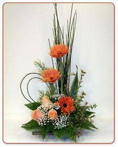 Arreglo en 3 gerberas y 3 rosas en base de bambú