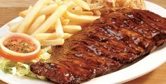 View the mouthwatering menu of Spur family & kids restaurants, it includes delicious starters, meals for sharing, steaks, ribs & more. People with a taste for life. Pork Spare Ribs, Pork Ribs, Bbq Ribs, Rib Recipes, Cooking Recipes, Spareribs Recipe, My Favorite Food, Favorite Recipes, Meat Platter